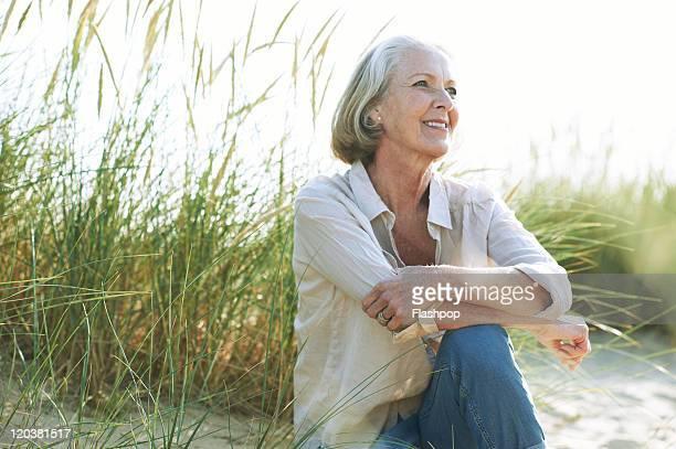 Senior woman relaxing at the beach