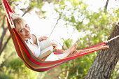 Senior Woman Relaxing In Hammock