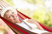 Senior Woman Relaxing In Hammock