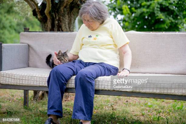 Senior Woman Relaxing In The Garden