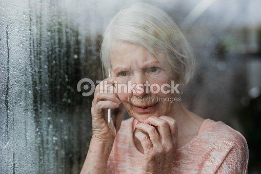 Senior Woman Reporting A Neighborhood Crime : Stock Photo