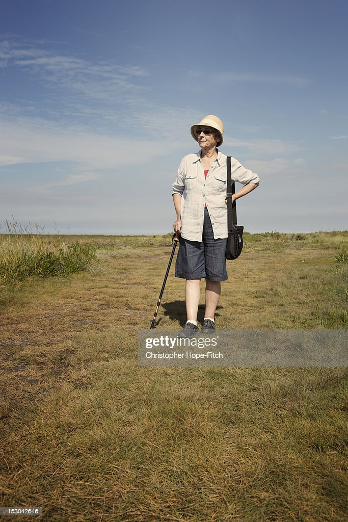 Senior woman resting while walking : Stock Photo