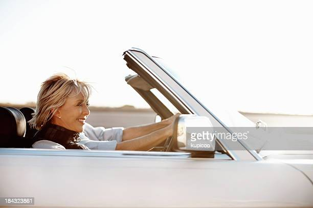 Senior woman riding in car with man