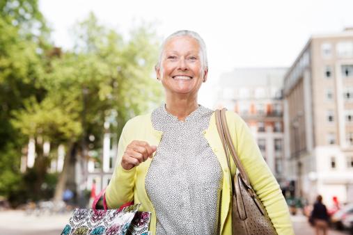 Senior woman shopping in city.