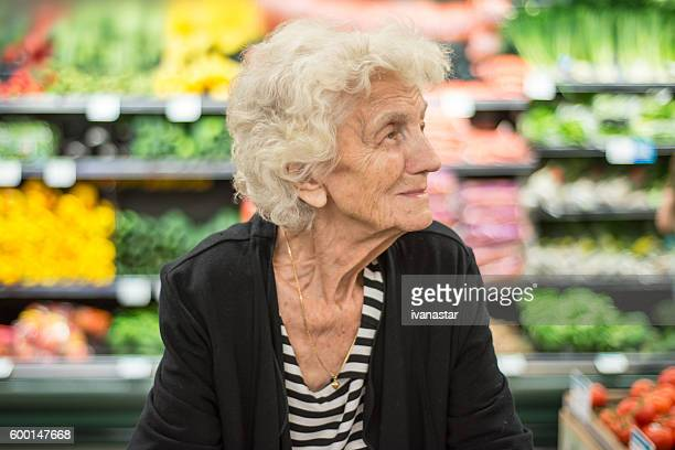 Senior Woman Shopping in Grocery Store