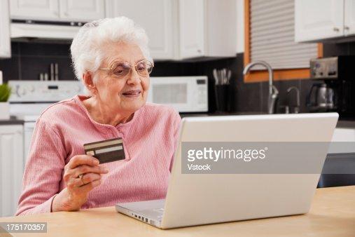 Senior woman shopping online : Stock Photo