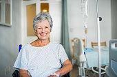 Senior woman sitting in a wheelchair in hospital