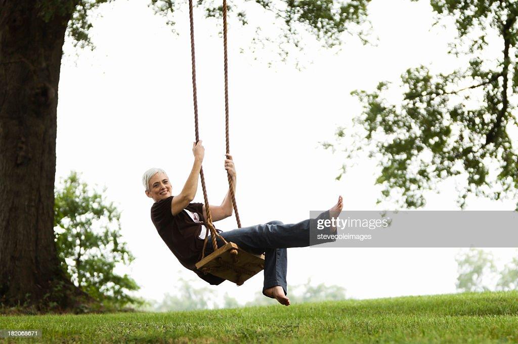 Senior Woman Sitting on a Swing