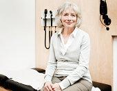 Senior Woman Sitting on an Examination Table