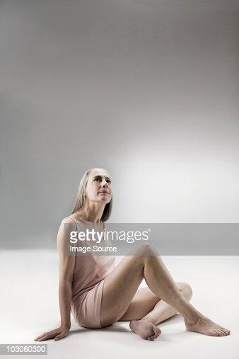 Senior woman sitting on floor