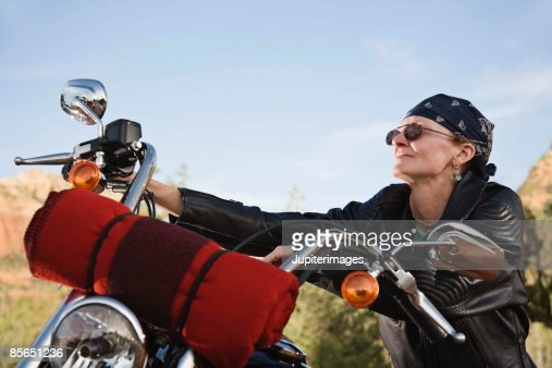 Senior woman sitting on motorcycle