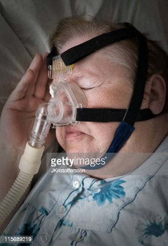 Senior Woman Sleeping with CPAP Mask : Stock Photo