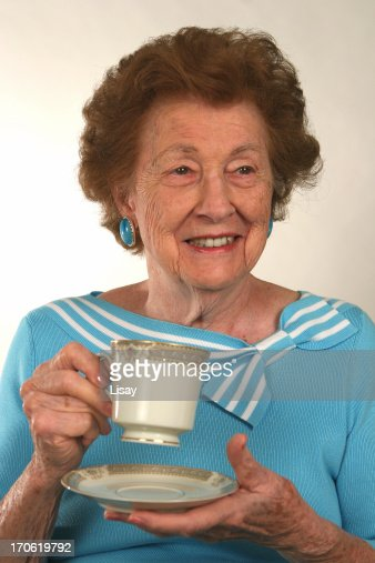 Senior woman smiling and holding tea cup