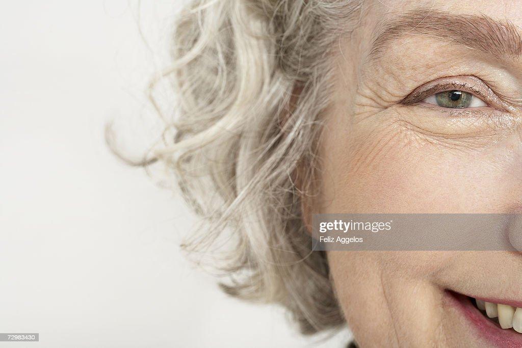 Senior woman, smiling, close-up, portrait : Stock Photo
