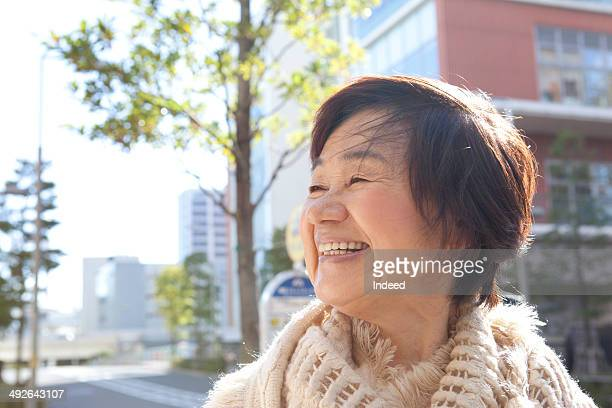 Senior woman smiling in town