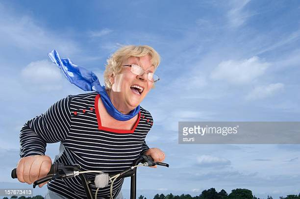 Senior Woman Speeding on a Bike