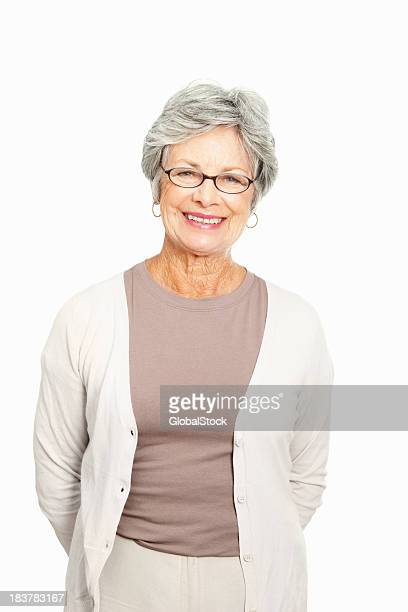 Senior woman standing on white background