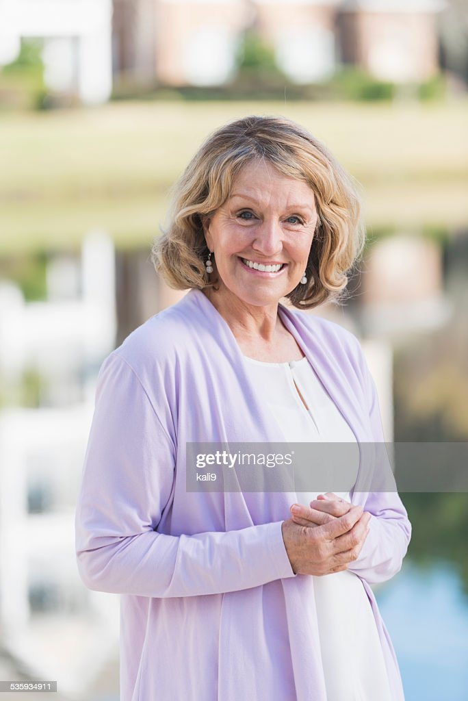Senior woman standing outdoors : Stock Photo