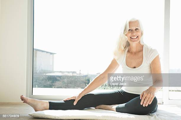 Senior woman stretching leg