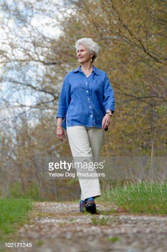 Senior woman taking a walk : Stock Photo