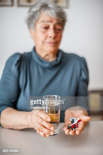 Senior Woman Taking Daily Medicine : Stock Photo