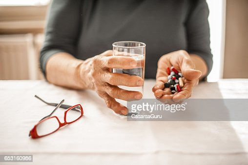 Senior Woman Taking Daily Medicine : Stock-Foto