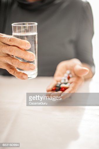 Senior Woman Taking Daily Medicine : ストックフォト