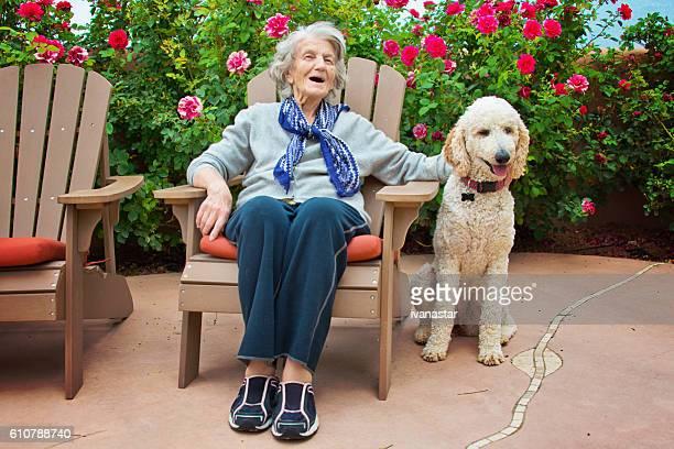 Senior Woman Talking to Service Dog