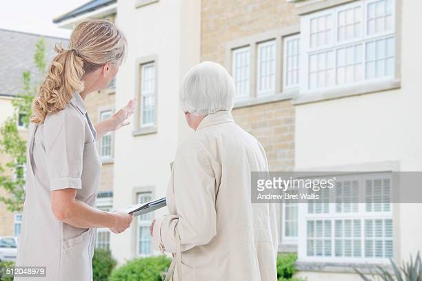 Senior woman talks with care home provider