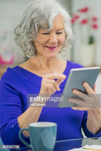 Senior Woman Using a Digital Tablet : ストックフォト