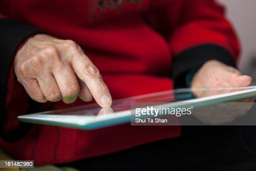 senior woman using digital tablet : Stock Photo