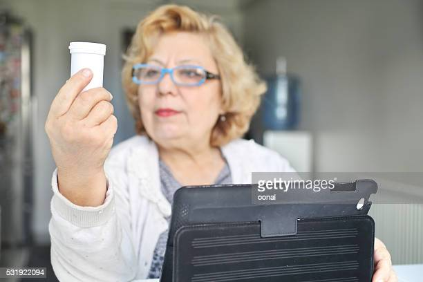 Senior woman using healthcare technology about medication