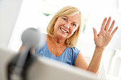 Senior woman using skype