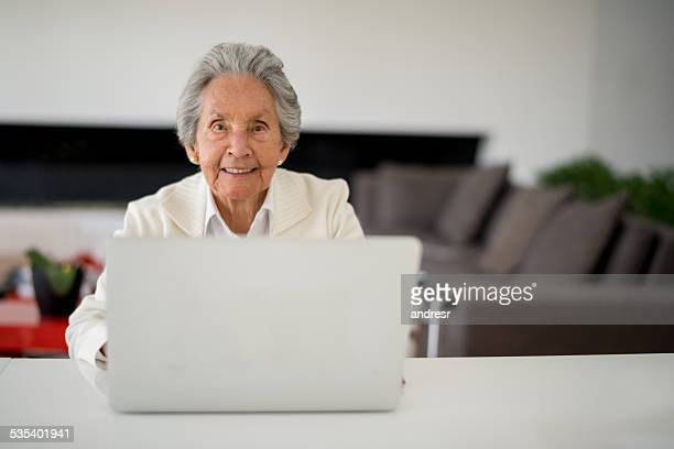 Senior woman using the computer
