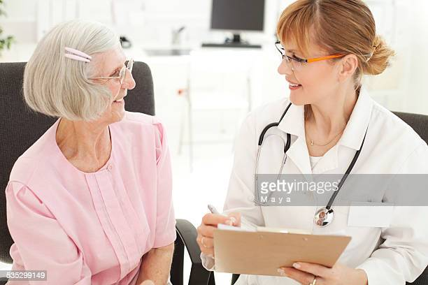Senior woman visiting doctor.