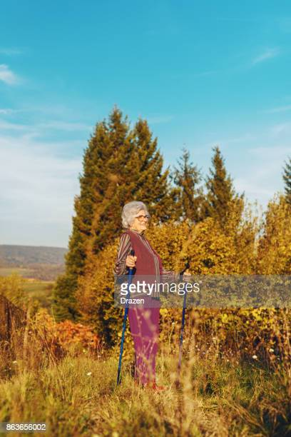 Senior woman walking outdoors in nature