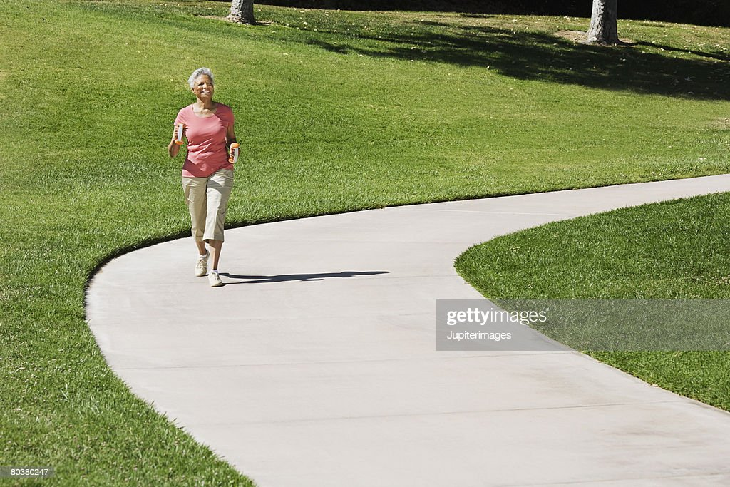 Senior woman walking : Stock Photo