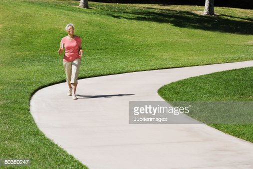 Senior woman walking : Foto stock