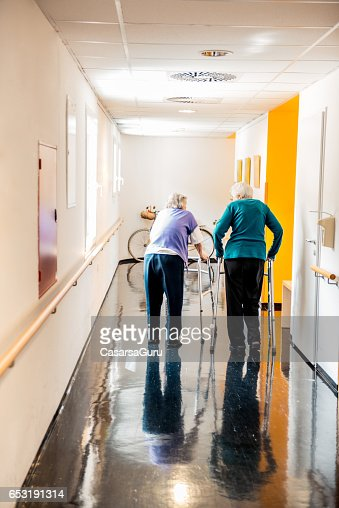 Senior Woman Walking With Mobility Walker In The Retirement Center : Stock-Foto