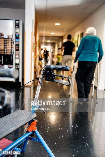 Senior Woman Walking With Mobility Walker In The Retirement Center : Stock Photo