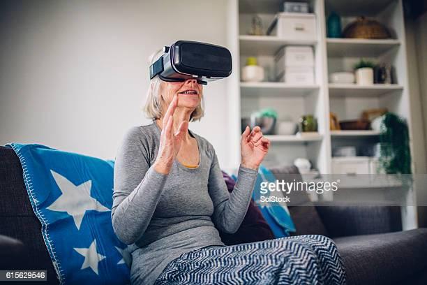 Senior Woman Wearing a VR Headset