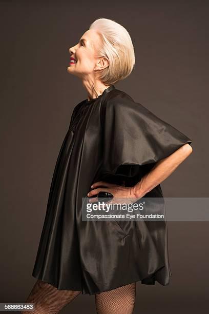Senior woman wearing black satin dress