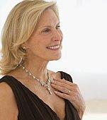 Senior woman wearing diamond necklace