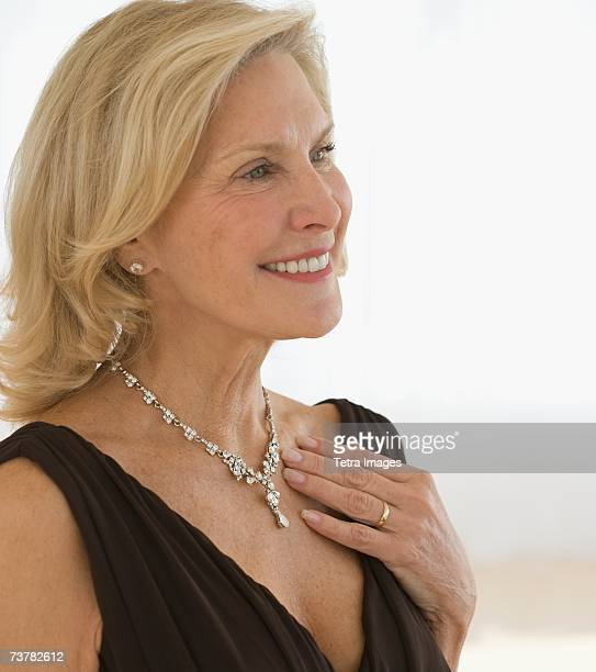 Senior woman wearing diamond necklace