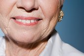 Senior woman wearing earrings