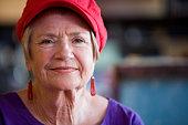 Senior Woman Wearing Red Hat