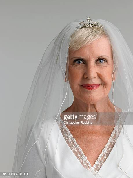 Senior woman wearing wedding dress, portrait