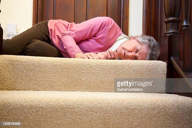 Senior woman who has fallen at her home stairway
