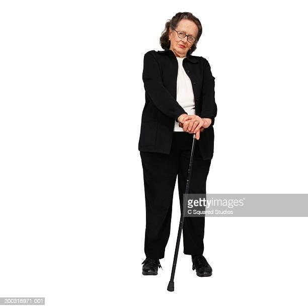 Senior woman with cane, portrait