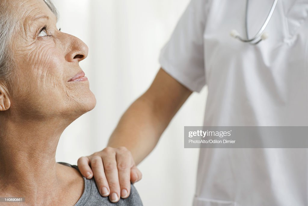 Senior woman with caring doctor, cropped : Stock Photo